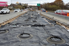 November 2019 - The viaduct's recently paved concrete deck is covered with a tarp during the curing process.
