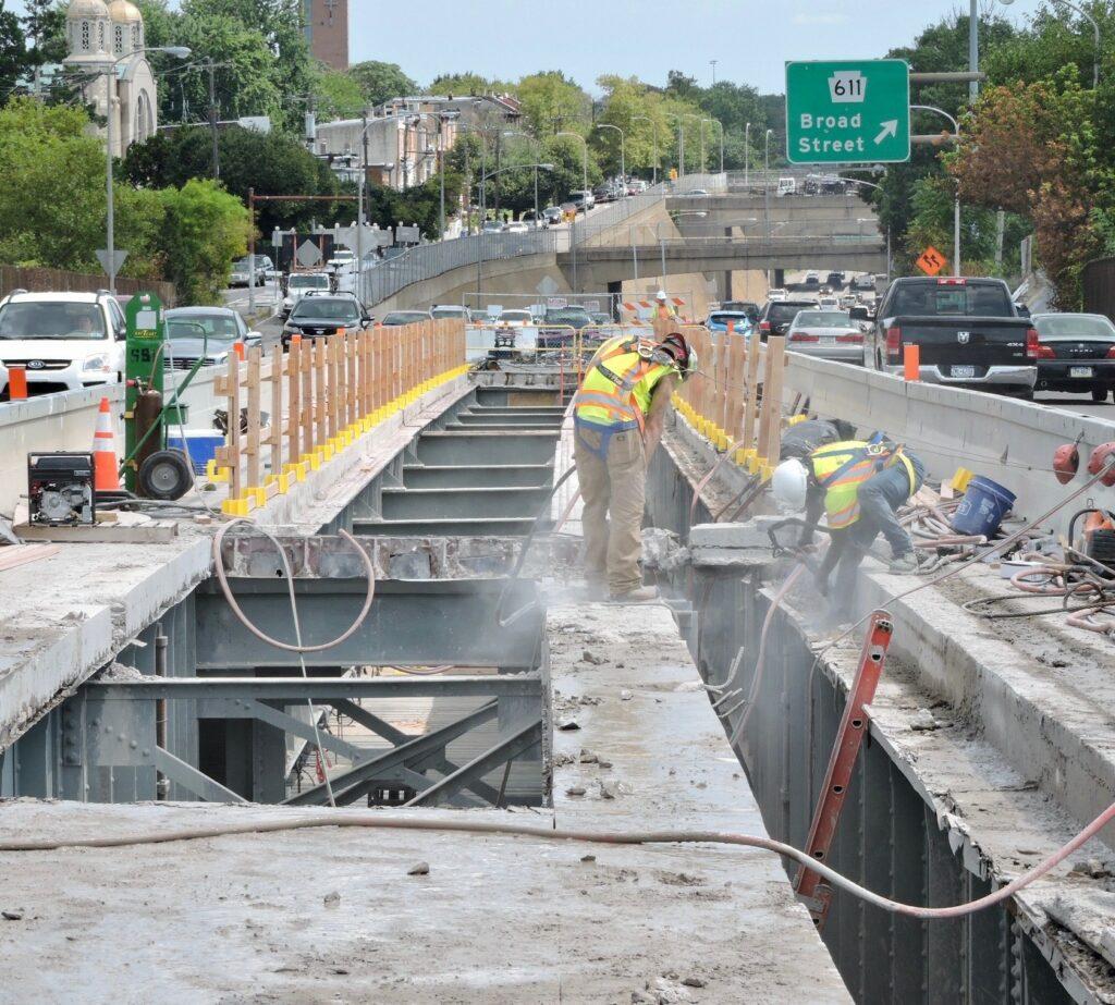 Crews remove the concrete deck